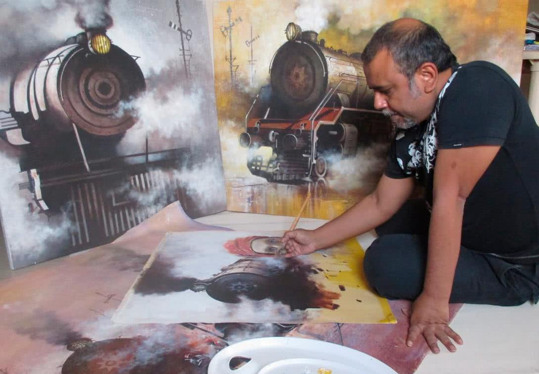 Kishore Pratim Biswas painting a Indian steam locomotive