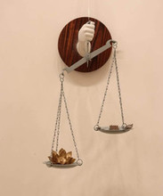 Mixedmedia Sculpture titled 'The Weight Of Faith' by artist Laxman Ahire