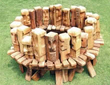 Wood Sculpture titled 'Gatgering' by artist Indira Ghosh
