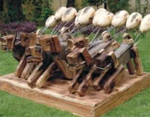 Wood and Iron scrap Sculpture titled 'Masquerades' by artist Indira Ghosh