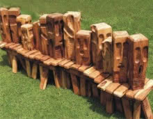 Wood Sculpture titled 'Queue' by artist Indira Ghosh