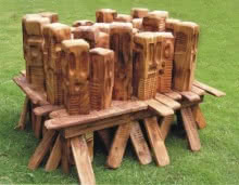 Wood Sculpture titled 'The Mob' by artist Indira Ghosh
