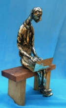 Bronze Sculpture titled 'The Laptop Boy' by artist Usha Ramachandran