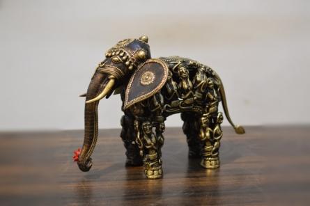Brass Sculpture titled 'Men Figure Elephant' by artist Kushal Bhansali