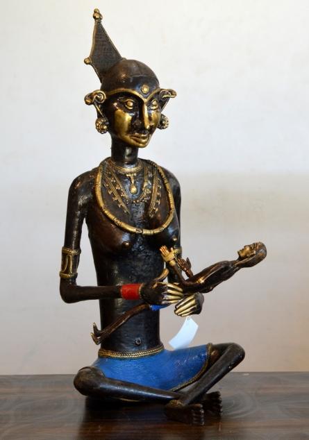 Brass Sculpture titled 'Tribal Working Lady Bachha Wali' by artist Kushal Bhansali