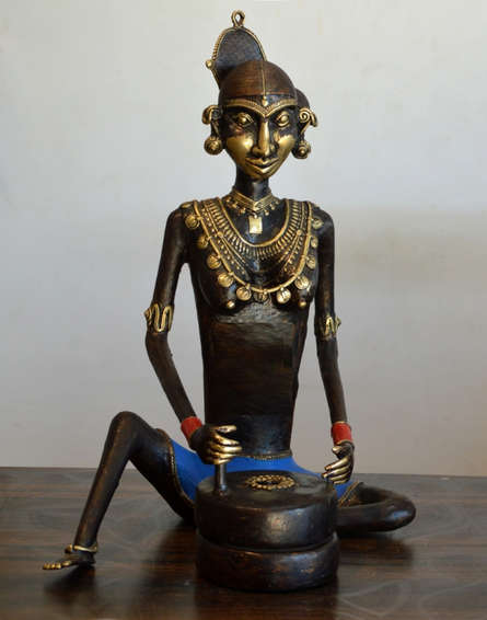Kushal Bhansali | Tribal Working Lady Jatawali Sculpture by artist Kushal Bhansali on Brass | ArtZolo.com