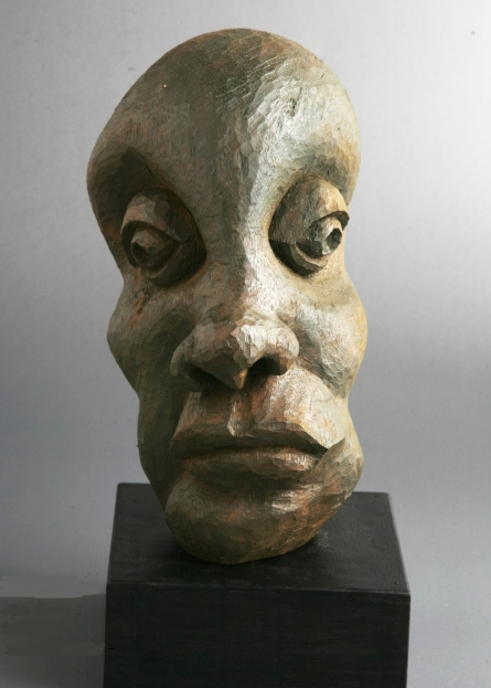 Wood Sculpture titled 'Distortion Of The Face 1' by artist Sucharita Adhikary