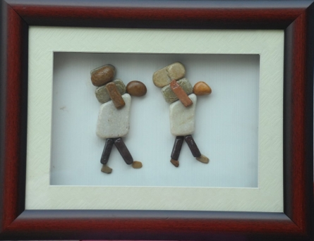 Two persons carrying weight | Sculpture by artist Jyothi Chinnapa Reddy | pebble stones