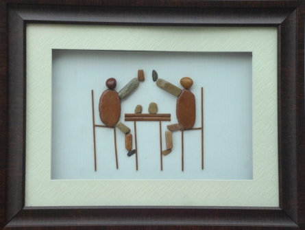 Two persons cheering glasses | Sculpture by artist Jyothi Chinnapa Reddy | pebble stones