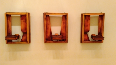 Wood Sculpture titled 'Social Inclusion 2' by artist Indira Ghosh