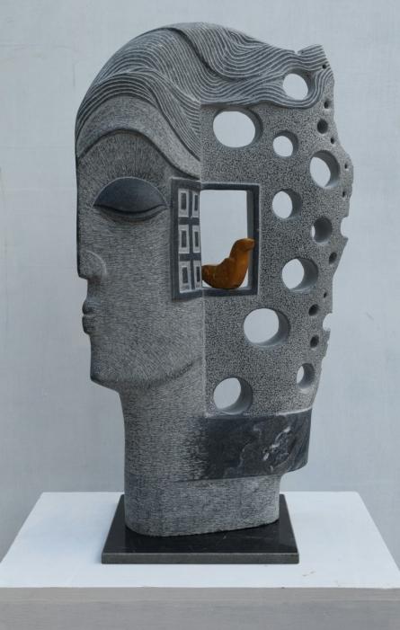 Black Marble Sculpture titled 'The Face' by artist Pankaj Gahlot