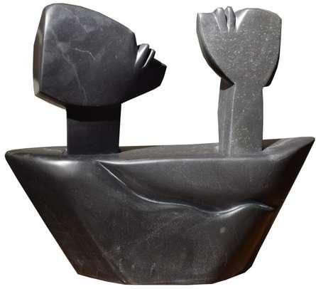Black Marble Sculpture titled 'Voyage 2' by artist Pradeep Jogdand