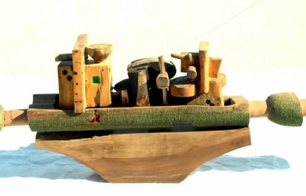 Wood Sculpture titled 'Blessed City' by artist Chander Parkash