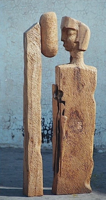 Wood Sculpture titled 'Father By The Lamp Post' by artist Chander Parkash