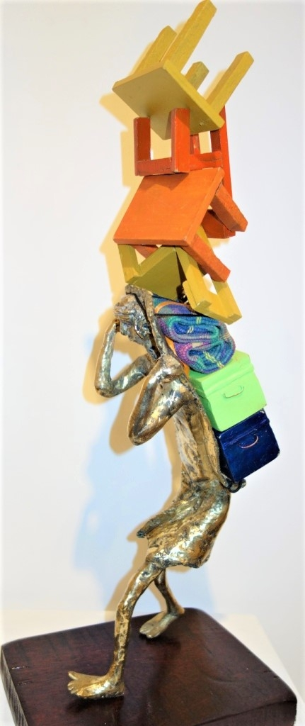 Wood, Bronze Sculpture titled 'The Daily Grind' by artist Usha Ramachandran