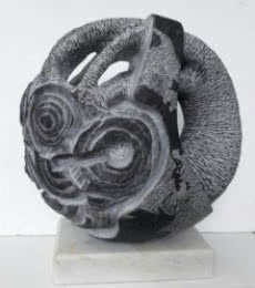 Black Marble Sculpture titled 'Save The Tree' by artist Nema Ram