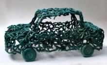 Bronze Sculpture titled 'Green Car' by artist Tarun Maity