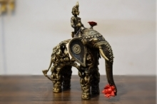 Kushal Bhansali | Men Figure Elephant With Sitting Men Sculpture by artist Kushal Bhansali on Brass | ArtZolo.com