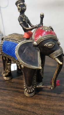 Brass Sculpture titled 'Elephant With Man' by artist Kushal Bhansali