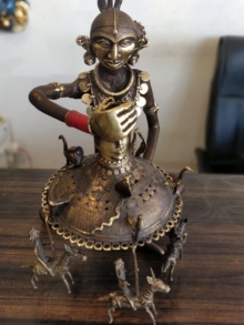Brass Sculpture titled 'Jhula Wali Lady' by artist Kushal Bhansali