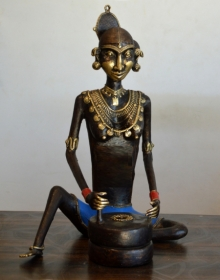 Brass Sculpture titled 'Tribal Working Lady Jatawali' by artist Kushal Bhansali