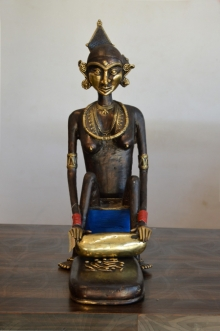 Brass Sculpture titled 'Tribal Working Lady Matni Wali' by artist Kushal Bhansali