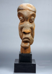 Wood Sculpture titled 'Distortion Of The Face 2' by artist Sucharita Adhikary