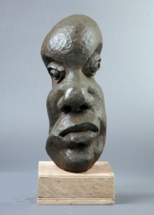 Wood Sculpture titled 'Distortion Of The Face 5' by artist Sucharita Adhikary