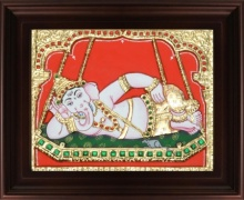 Traditional Indian art title Swinging Ganesha on Jhula Tanjore on Plywood - Tanjore Paintings