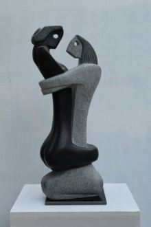 Black Marble Sculpture titled 'Embracing' by artist Pankaj Gahlot