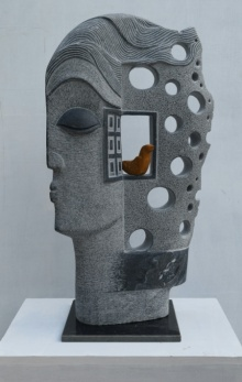Black Marble Sculpture titled 'The Face' by artist Pankaj Gahlot
